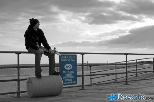 picDescrip.com - Photography and Art - Do not sit or climb on railNO:Ball Playing, Frisbees, Skateboards, Bicycles, Glass on Beach