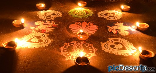 "picDescrip.com - Nightlife - Rangoli..   Its a traditional painting/art done with some colourful grains/powder in a festival named ""Deepawali"" in India. In this festival we celebrate with lights and fireworks and such rangolies."
